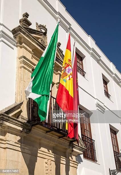 Flags outside the Ayuntiamiento Plaza del Cabildo village of Arcos de la Frontera Cadiz province Spain