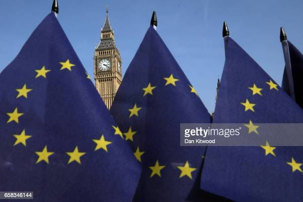 EU flags outside the Houses of Parliament on March 27 2017 in London England Article 50 will be triggered on March 29 and the process that will take...