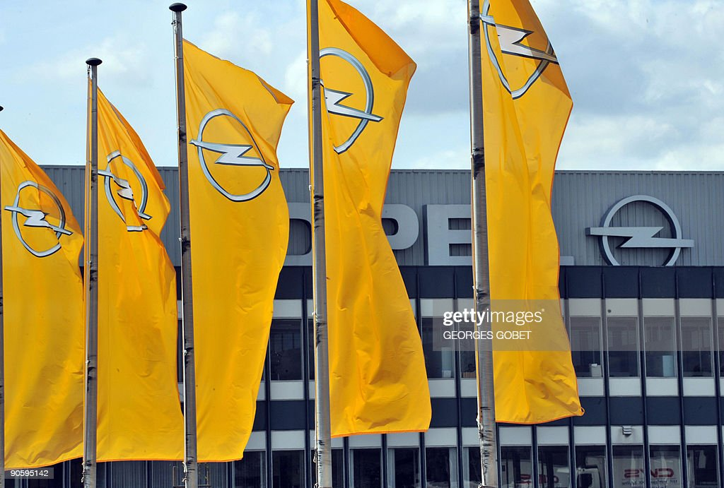 Flags outside the Opel car factory building are pictured in Antwerp on September 11 2009 General Motors vicepresident John Smith said Thursday in...