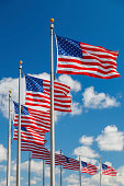 US Flags over blue sky