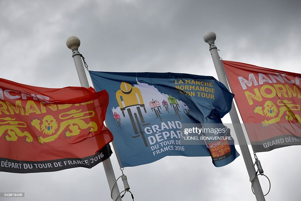 Flags reading in French 'The 2016 Tour de France's Great Departure' are pictured in Saint-Lo, Normandy, on June 29, 2016, three days before the start of the 103rd edition of the Tour de France cycling race. The 2016 Tour de France will start on July 2 in the streets of Le Mont-Saint-Michel and ends on July 24, 2016 down the Champs-Elysees in Paris. / AFP / LIONEL