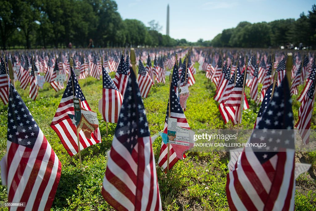 Flags representing fallen soldiers are planted on the National Mall during the annual Rolling Thunder 'Ride for Freedom' parade ahead of Memorial Day in Washington, DC, on May 29, 2016. / AFP / Andrew Caballero-Reynolds