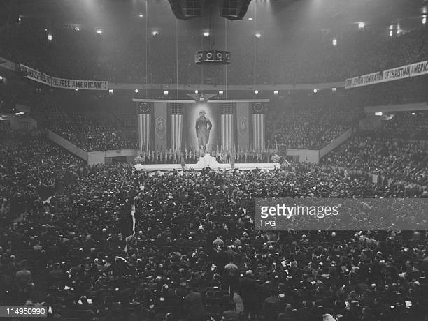 US flags swastikas and a portrait of George Washington at a meeting of the German American Bund held at Madison Square Garden New York City 20th...
