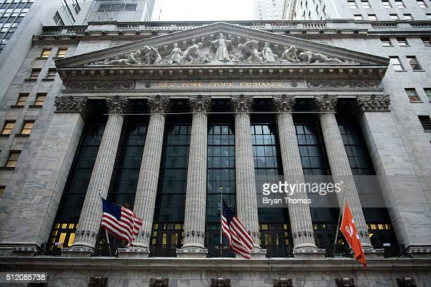 Flags wave in front of the New York Stock Exchange on February 24 2016 in New York City The Dow Jones industrial average was up 5321 points on...