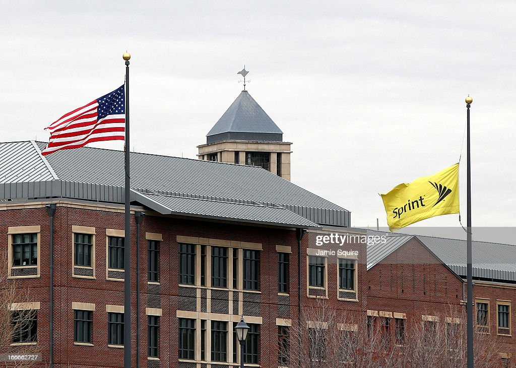 Flags wave in front of the Sprint Nextel operational headquarters after Dish Network made a $25.5 billion bid for the company on April 15, 2013 in Overland Park, Kansas. The satellite TV provider's unsolicited offer comes at a time when Sprint needs a cash infusion to avoid bankruptcy. Sprint is already considering a previous 20.1 billion bid from Japanese tech company Softbank.