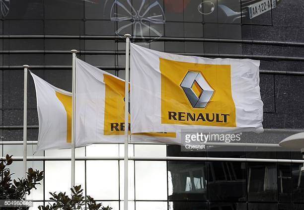 Flags with Renault logo fly in front of French carmaker Renault headquarters on January 14 2016 in BoulogneBillancourt France Shares in French...