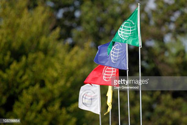 Flags with the tournament logo is seen during the first round of the World Golf Championships Bridgestone Invitational on the South Course at...