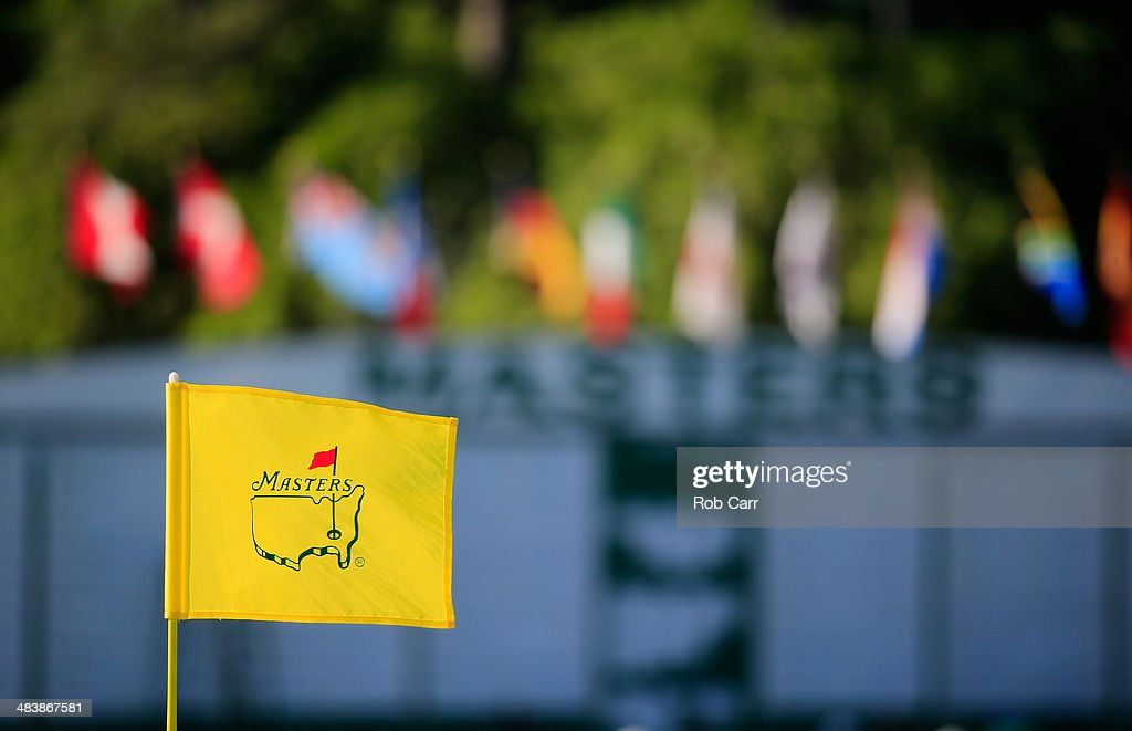 A flagstick and leaderboard are seen during the first round of the 2014 Masters Tournament at Augusta National Golf Club on April 10, 2014 in Augusta, Georgia.