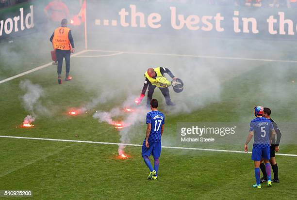 Flairs are thrown onto the pitch during the UEFA EURO 2016 Group D match between Czech Republic and Croatia at Stade GeoffroyGuichard on June 17 2016...