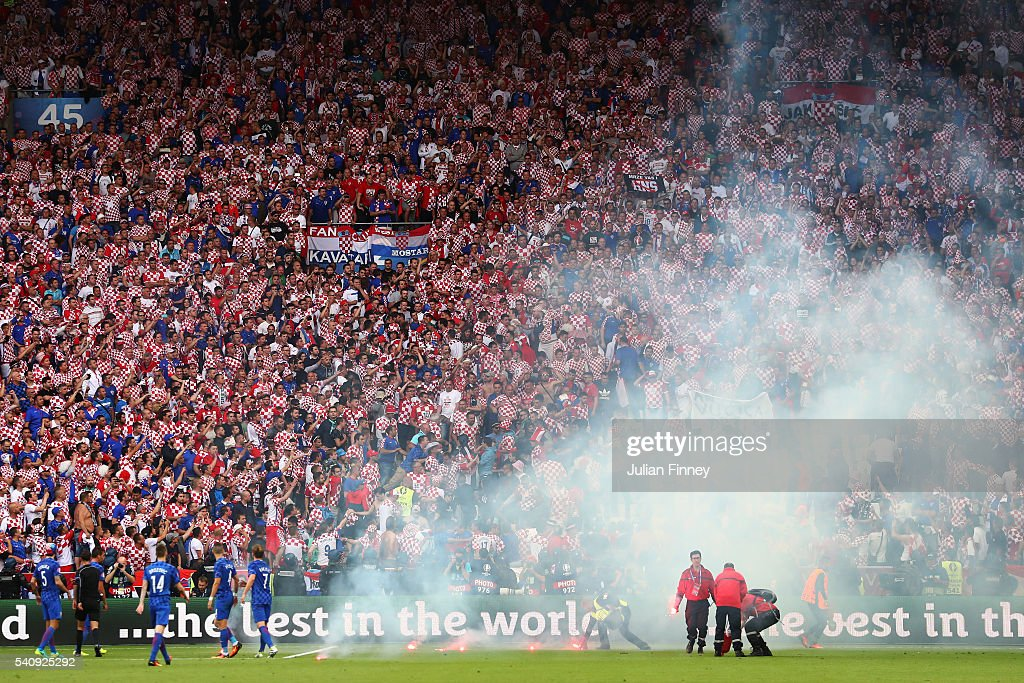 Flairs are thrown onto the pitch during the UEFA EURO 2016 Group D match between Czech Republic and Croatia at Stade Geoffroy-Guichard on June 17, 2016 in Saint-Etienne, France.