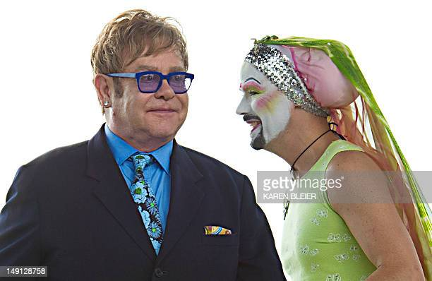 Flamboyant British pop icon Elton John walks to the podium to read names appearing on the AIDS Quilt on the National Mall July 23 2012 as part of the...