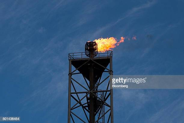 A flame blazes on top of a gas burn off venting pipe on the Armada gas condensate platform operated by BG Group Plc in the North Sea off the coast of...