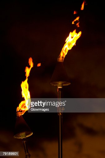 Flame burning from tiki torches : Stock Photo