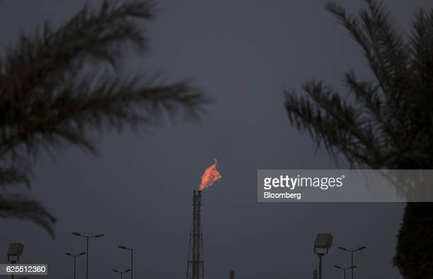 A flame burns from a chimney at the phosphate processing plant at the Ras Al Khair Industrial City operated by the Saudi Arabian Mining Co in Ras Al...
