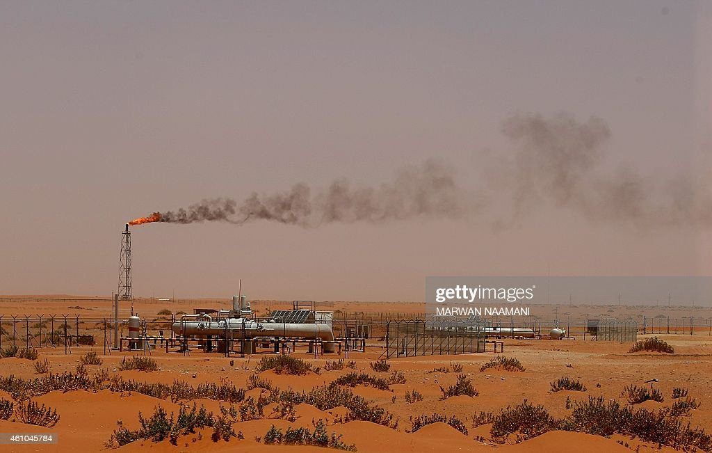 A flame from a Saudi Aramco oil installion known as 'Pump 3' is seen in the desert near the oilrich area of Khouris 160 kms east of the Saudi capital...