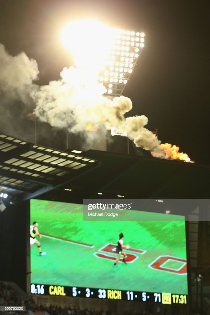 A flame is seen coming from top of the scoreboard during the round one AFL match between the Carlton Blues and the Richmond Tigers at Melbourne Cricket Ground on March 23, 2017 in Melbourne, Australia.