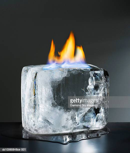 Flame over ice cube, close-up