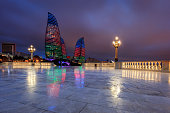 The Flame Towers in Baku, Azerbaijan seen at a rainy sunset from the Upland Park