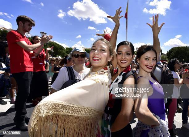 Flamenco amateur dancers perform during a street action to announce the 3rd edition of 'Flamenco Madrid 2017' in the Plaza de Colon in Madrid on May...