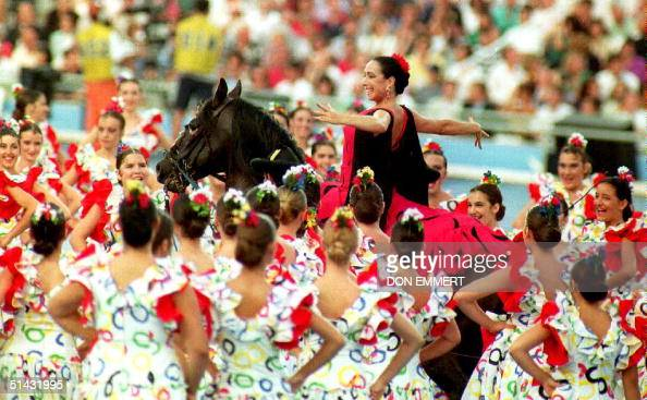 Flamenco dancer Cristina Hoyos rides a horse 25 July 1992 as she passes through dancers during the opening ceremony of the XXVth Summer Olympics Some...