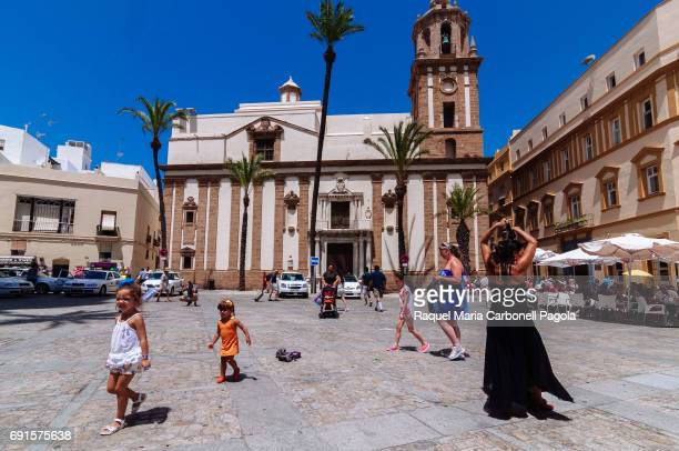 Flamenco dancer dancing for tourists in front of Santiago Church in the Cathedral square