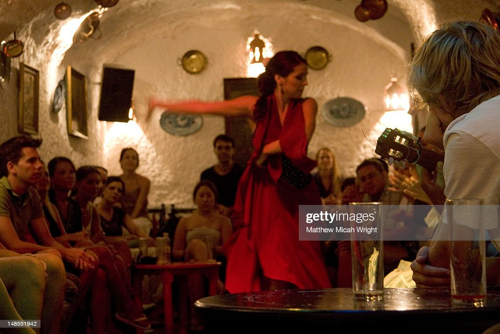 Flamenco dancer performing for tourists in Sacromonte Caves.