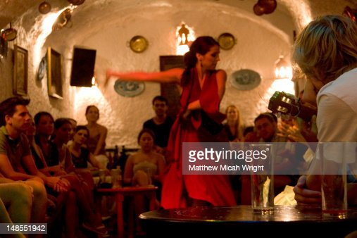 Flamenco dancer performing for tourists in Sacromonte Caves. : Stock Photo