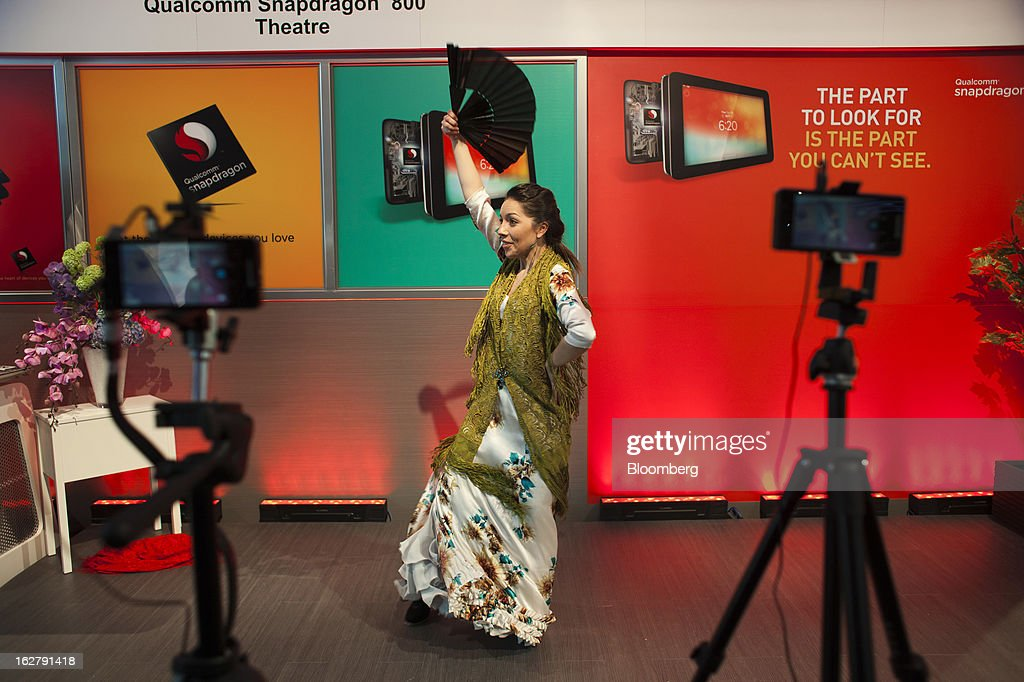 A flamenco dancer performs during a presentation of the Qualcomm Inc. Snapdragon 800 processor at the Mobile World Congress in Barcelona, Spain, on Wednesday, Feb. 27, 2013. The Mobile World Congress, where 1,500 exhibitors converge to discuss the future of wireless communication, is a global showcase for the mobile technology industry and runs from Feb. 25 through Feb. 28. Photographer: Angel Navarrete/Bloomberg via Getty Images
