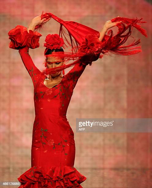 A flamenco dancer presents a creation by Mari Carmen Cruz during the second day of the SIMOF in Sevilla on January 31 2014 AFP PHOTO/ GOGO LOBATO