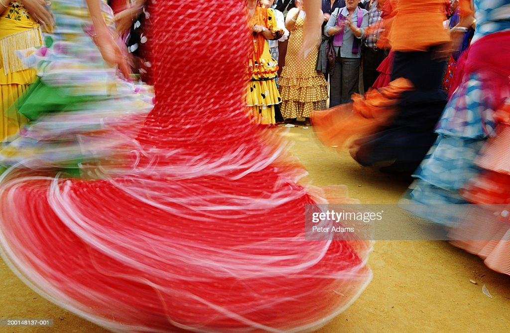 Flamenco dancers spinning, low section (blurred motion) : Stock Photo