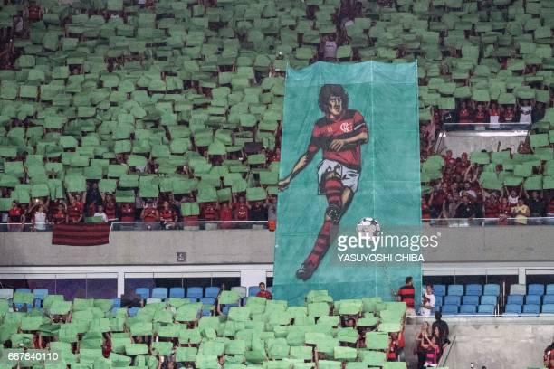 Flamengo fans cheer during their 2017 Copa Libertadores football match Against Atletico Paranaense at Maracana stadium in Rio de Janeiro Brazil on...