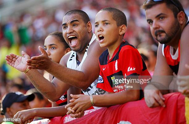 Flamengo supporters cheer during a match between Flamengo and Palmeiras as part of Brasileirao Series A 2014 at Maracana Stadium on May 04 2014 in...