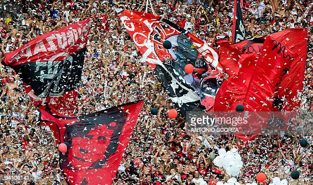 Flamengo supporters cheer their team before the start of the Brazilian Championship final date match against Gremio at the Maracana stadium on...