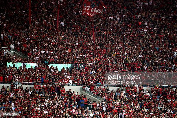 Flamengo's fan cheer during their Brazilian championship match against Gremio at Maracana stadium in Rio de Janeiro Brazil on September 6 2014 AFP...