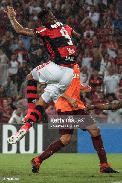 Flamengo's Guerrero jumps for the ball to make his first goal against Atletico Paranaense during their 2017 Copa Libertadores football match at...