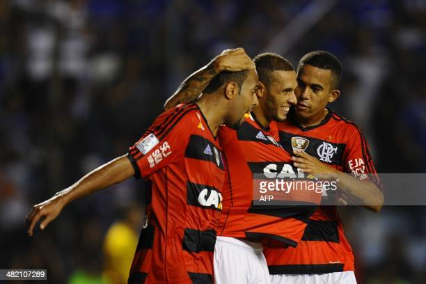 Flamengo's Paulinho elebrates with teammates after scoring against Emelec from Ecuador during their 2014 Copa Libertadores football match at George...