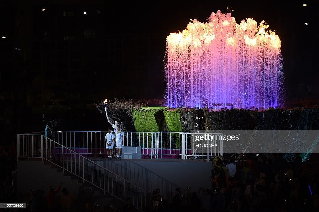 A flamer courier poses in front of the flame during the opening ceremony of the 2014 Asian Games at the Incheon Asiad Main Stadium in Incheon on...