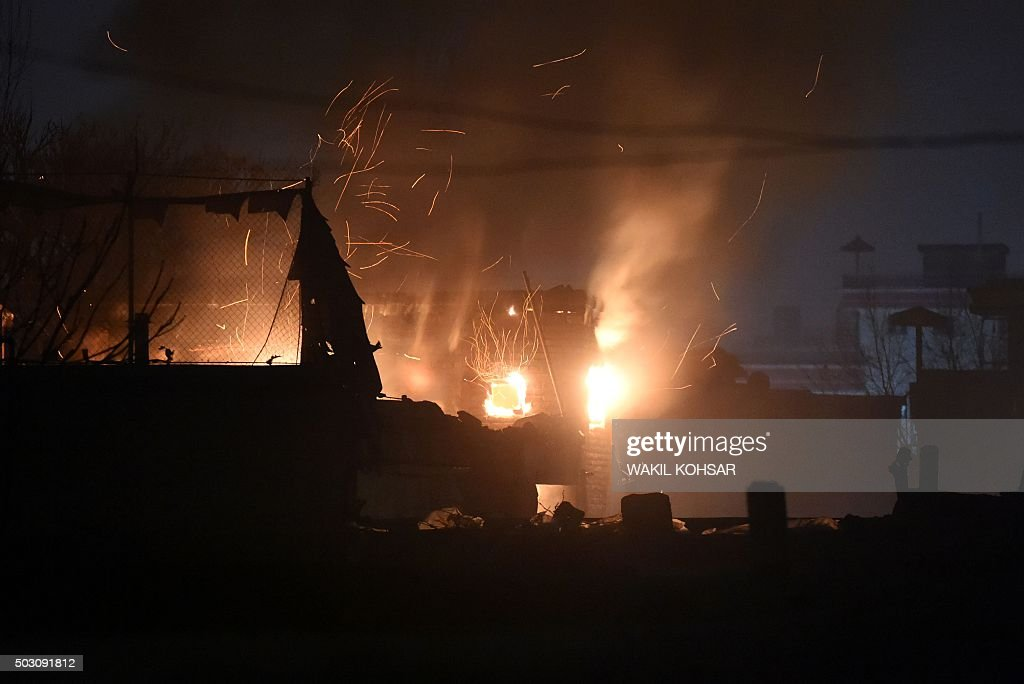 Flames And Smoke Rise At The Site Of A Suicide Car Bomb