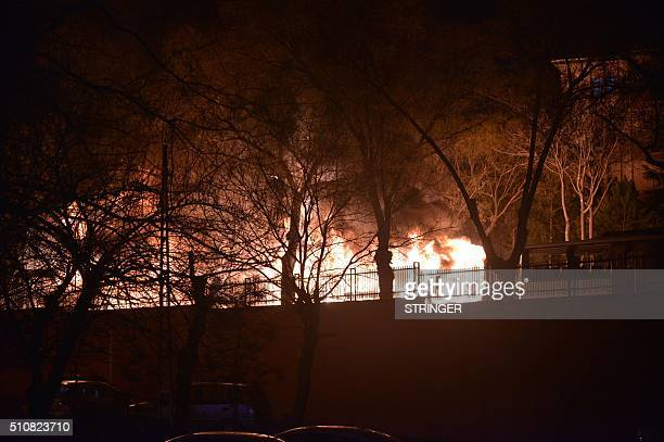 Flames are seen following an explosion after an attack targeted a convoy of military service vehicles in Ankara on February 17 2016 At least five...