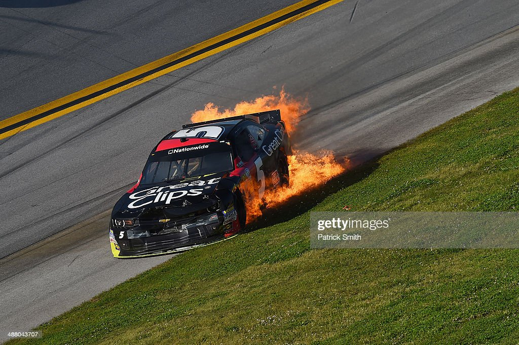 Flames are seen from the car of Kasey Kahne, driver of the #5 Great Clips Chevrolet, during the NASCAR Nationwide Series Aaron's 312 at Talladega Superspeedway on May 3, 2014 in Talladega, Alabama.