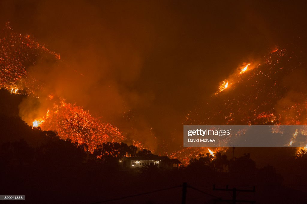 Flames come close to a house as the Thomas Fire advances toward Santa Barbara County seaside communities on December 10, 2017 in Carpinteria, California. The Thomas Fire has grown to 173,000 acres and destroyed at least 754 structures so far. Strong Santa Ana winds have been feeding major wildfires all week, destroying houses and forcing tens of thousands of people to evacuate.