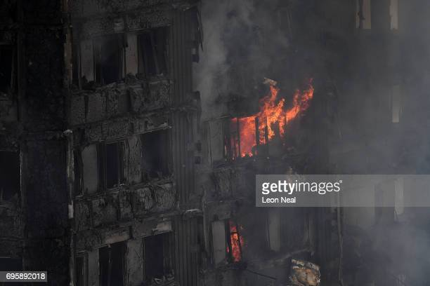 Flames continue to burn after a huge fire engulfed the 24 storey residential Grenfell Tower block in Latimer Road West London in the early hours of...