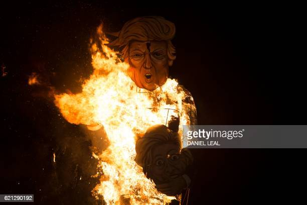 Flames engulf an effigy of US presidential candidate Donald Trump as it is burned as the 'Celebrity Guy' at the Edenbridge Bonfire Society bonfire...