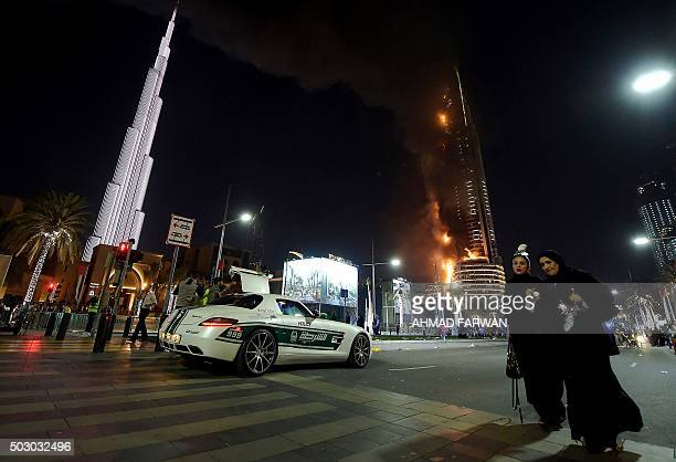 Flames engulf the Address Downtown hotel after it was hit by a massive fire near the world's tallest tower Burj Khalifa in Dubai on December 31 2015...