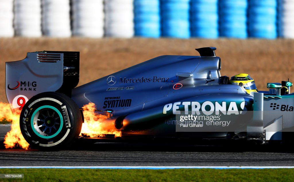 Flames erupt from the W04 belonging to <a gi-track='captionPersonalityLinkClicked' href=/galleries/search?phrase=Nico+Rosberg&family=editorial&specificpeople=800808 ng-click='$event.stopPropagation()'>Nico Rosberg</a> of Germany and Mercedes GP during Formula One winter testing at Circuito de Jerez on February 5, 2013 in Jerez de la Frontera, Spain.