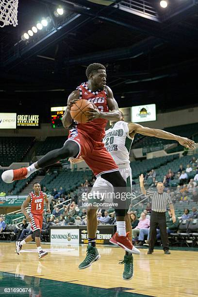 Flames F/C Clint Robinson grabs a rebound against Cleveland State Vikings G Bobby Word during the first half of the NCAA Men's Basketball game...