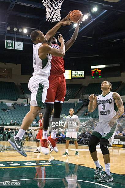 Flames F/C Clint Robinson is fouled by Cleveland State Vikings F Demonte Flannigan as Cleveland State Vikings G Rob Edwards looks on during the...