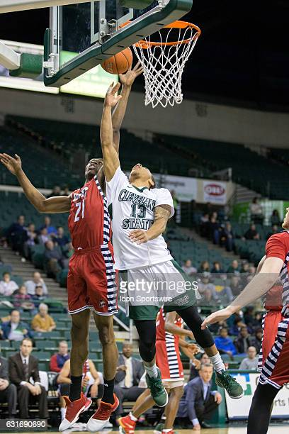 Flames F/C Tai Odiase defends the shot of Cleveland State Vikings G Nelson Maxwell during the first half of the NCAA Men's Basketball game between...