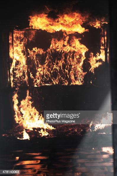 Flames inside a shipping container photographed during a Wiltshire Fire And Rescue Service training exercise at Cotswold Airport in Gloucestershire...