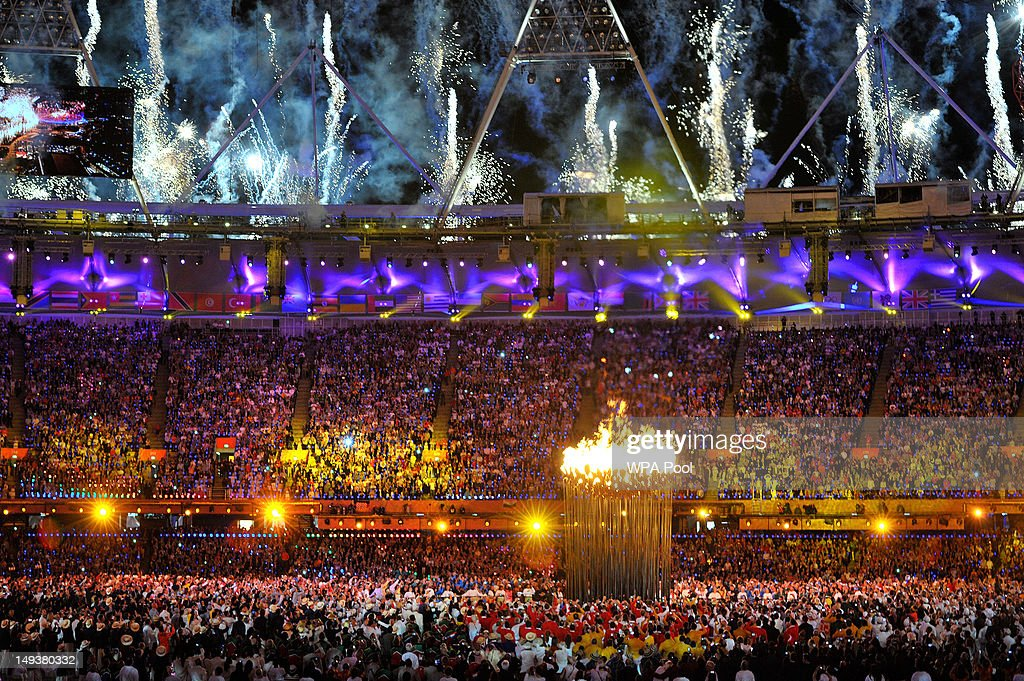 Flames leap from the cauldron and fireworks explode during the Opening Ceremony of the London 2012 Olympic Games at the Olympic Stadium on July 27, 2012 in London, England.